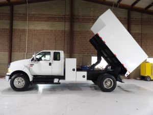 2010 FORD F750 EXTENDED CAB, 12' CHIP BODY