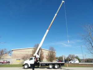 2007 STERLING LT7500, 20' FLATBED, 80' SHEAVE HEIGHT TEREX BT3470 MODEL CRANE