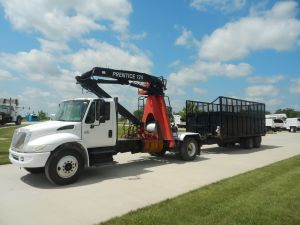 2005 International 4300 with Prentice 124 Log loader and 20 ft. Conel Dump Trailer with Hi-Capacity Sides