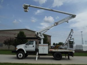 2006 Ford F750 4X4 11 Ft. Southco Flatbed 60 Ft. Altec LRV55 Model Boom