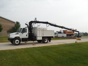 2005 International 4300 12 ft. dump bed with removable top, 35 ft. extendable LogLift 75Z model Grapple
